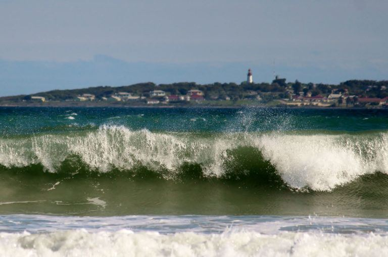 wave crashing in front of robben island